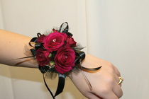 Wine and black spray rose wrist corsage from The Posie Shoppe in Prineville, OR