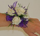 Purple and white spray rose wrist corsage from The Posie Shoppe in Prineville, OR