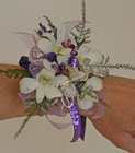 White and purple dendrobium orchid wrist corsage from The Posie Shoppe in Prineville, OR