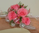 Pink spray rose wrist corsage from The Posie Shoppe in Prineville, OR