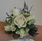 Black and white spray rose wrist corsage from The Posie Shoppe in Prineville, OR