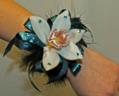 Teal and black cymbidium orchid corsage from The Posie Shoppe in Prineville, OR