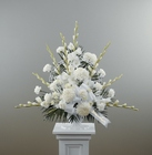 Traditional white basket sympathy arrangement from The Posie Shoppe in Prineville, OR