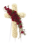 White cross with roses from The Posie Shoppe in Prineville, OR