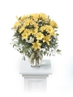 Yellow vased arrangement from The Posie Shoppe in Prineville, OR