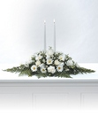 White candle arrangement from The Posie Shoppe in Prineville, OR