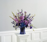 Vased arrangement in purples and blues from The Posie Shoppe in Prineville, OR