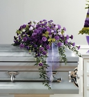 Purple and lavender carnation casket spray from The Posie Shoppe in Prineville, OR