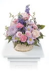 Pink and lavender basket arrangement from The Posie Shoppe in Prineville, OR