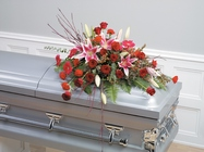 Stargazer and rose casket spray from The Posie Shoppe in Prineville, OR