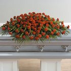 Red carnation full casket spray from The Posie Shoppe in Prineville, OR