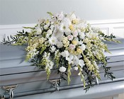 White Casket Spray with knitting accents from The Posie Shoppe in Prineville, OR