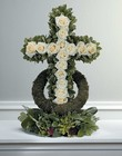 White rose accented cross from The Posie Shoppe in Prineville, OR