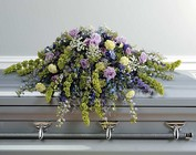 Lavender and blue casket spray from The Posie Shoppe in Prineville, OR