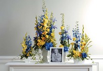 Blue and yellow memorial setting from The Posie Shoppe in Prineville, OR