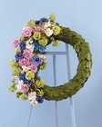 Leaf covered wreath with floral accent from The Posie Shoppe in Prineville, OR