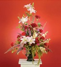Red and pink arrangement featuring lilies from The Posie Shoppe in Prineville, OR