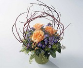 Roses and branches arrangement from The Posie Shoppe in Prineville, OR