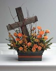 Driftwood cross in floral hedge from The Posie Shoppe in Prineville, OR