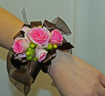 Pink and brown rose wristlet corsage from The Posie Shoppe in Prineville, OR